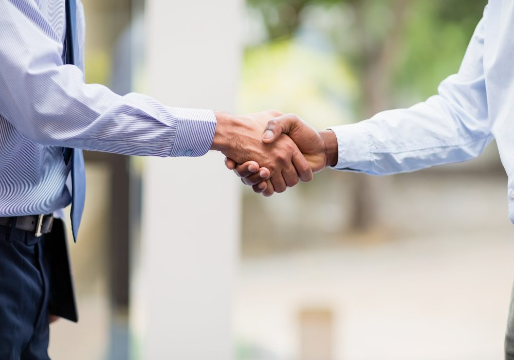 Close-up of business executives shaking hands